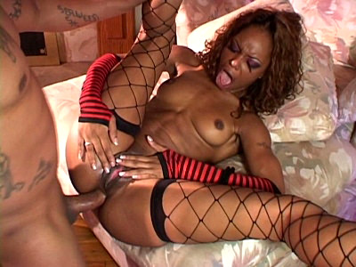 Horny Marie Luv is all ready for some kinky fucking. This hot black chick is wearing her red leather corset and net stockings as she puts on a show of sucking her lovers huge dick and then spreading wide to have her hot ass fucked and her face cumhosed.